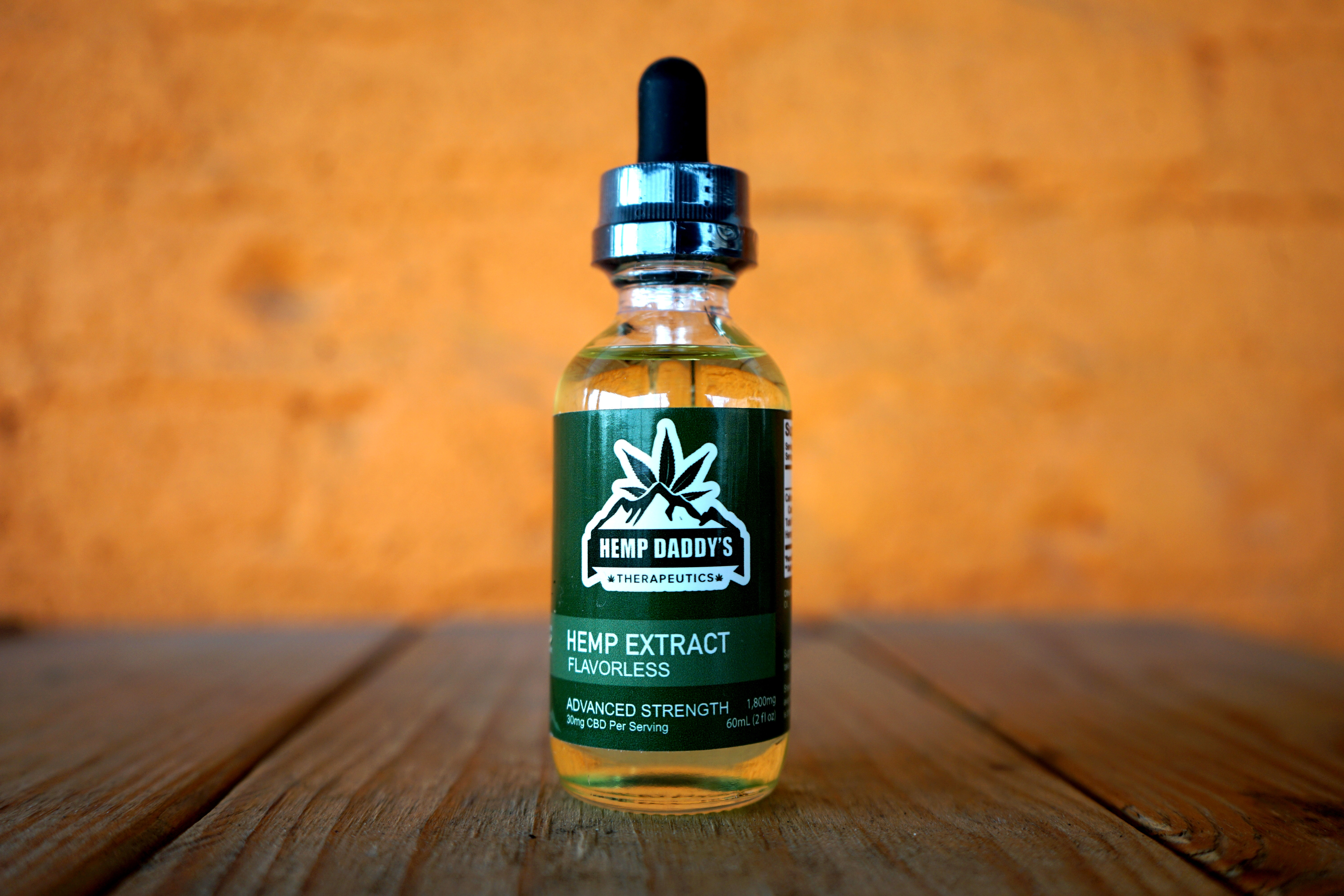Image of CBD oil bottle on wooden table