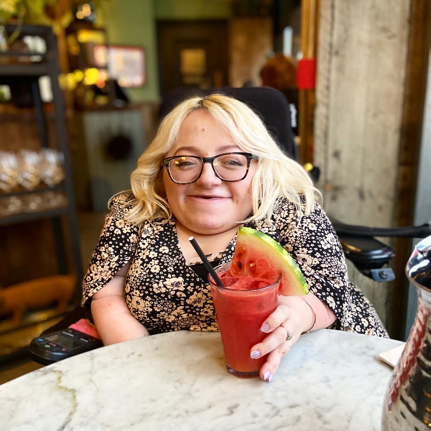 Gem smiling with red watermelon drink